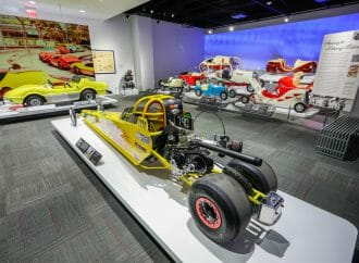 Child-size cars on display at the Petersen