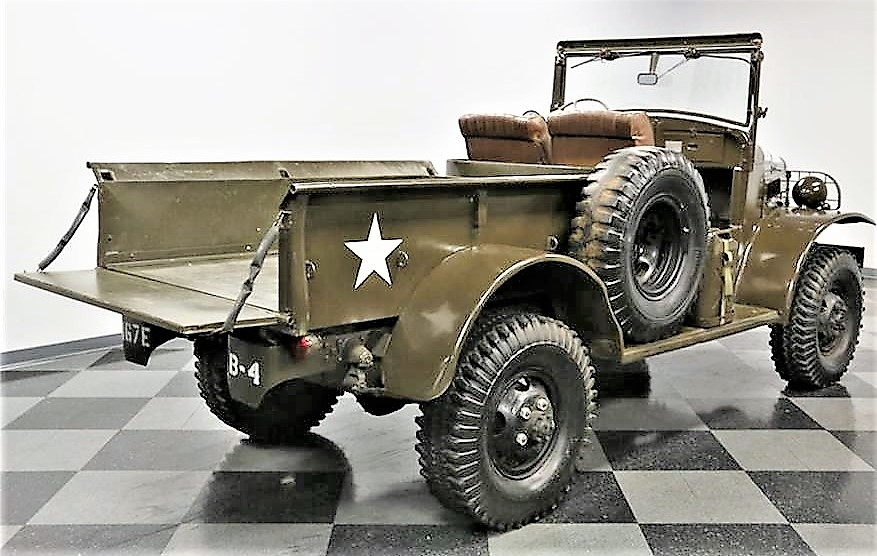 The half-ton pickup is in full military trim