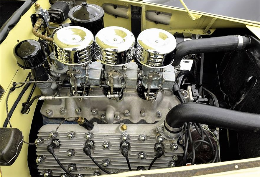 The Allard's flathead V8 is fed by a set of triple Strombergs