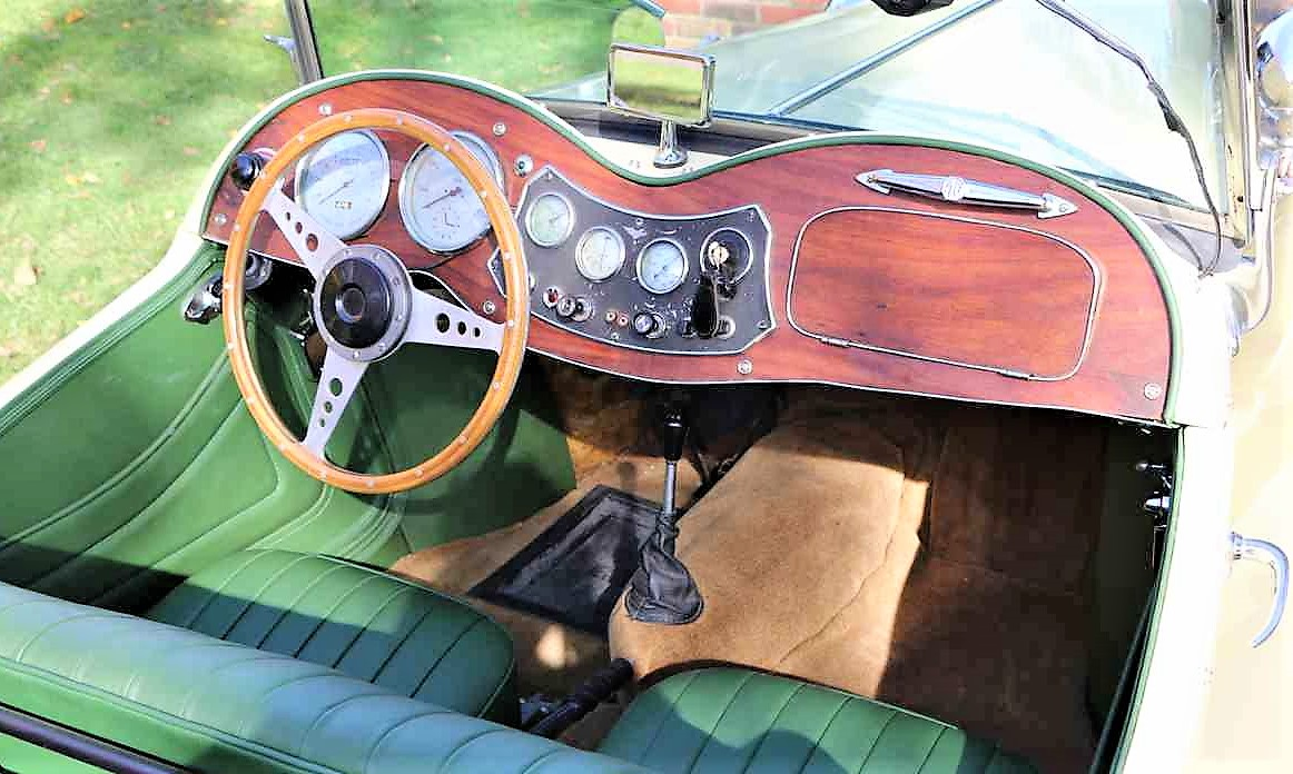 The snug interior features a wood dashboard