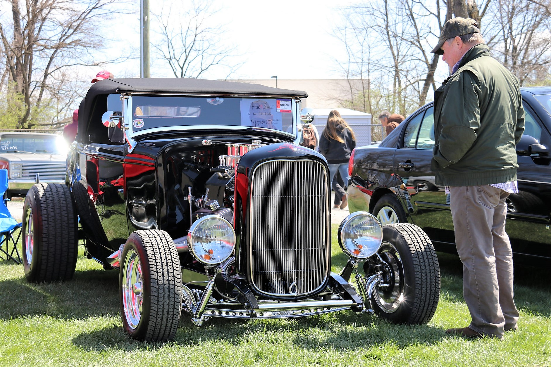 A prospective buyer studies a Ford hot rod at Spring Carlisle | Carlisle Events