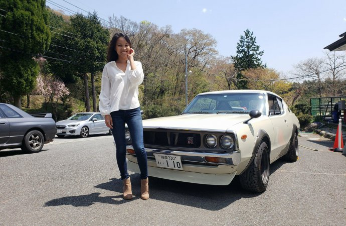 Driving a Nissan Skyline with Mount Fuji in the rearview mirror