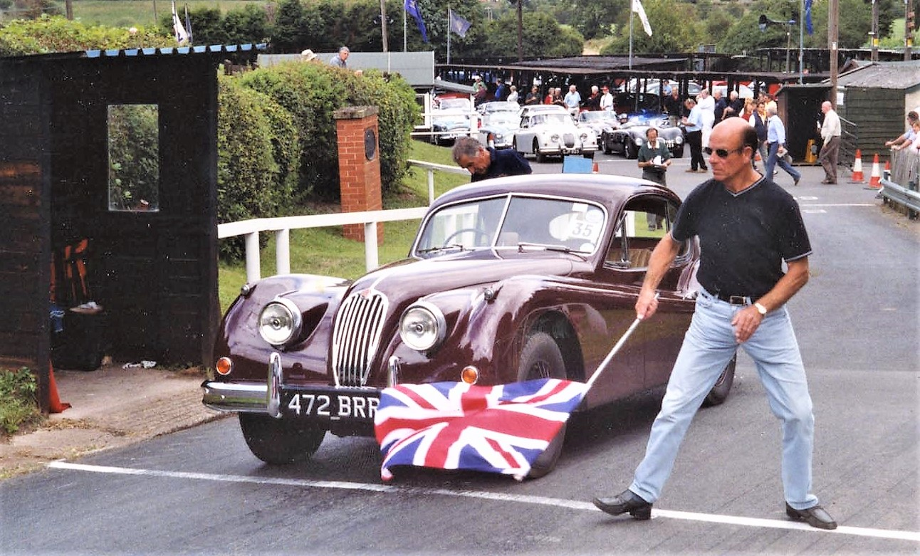 A Jaguar XK120 on the start line | XK Club
