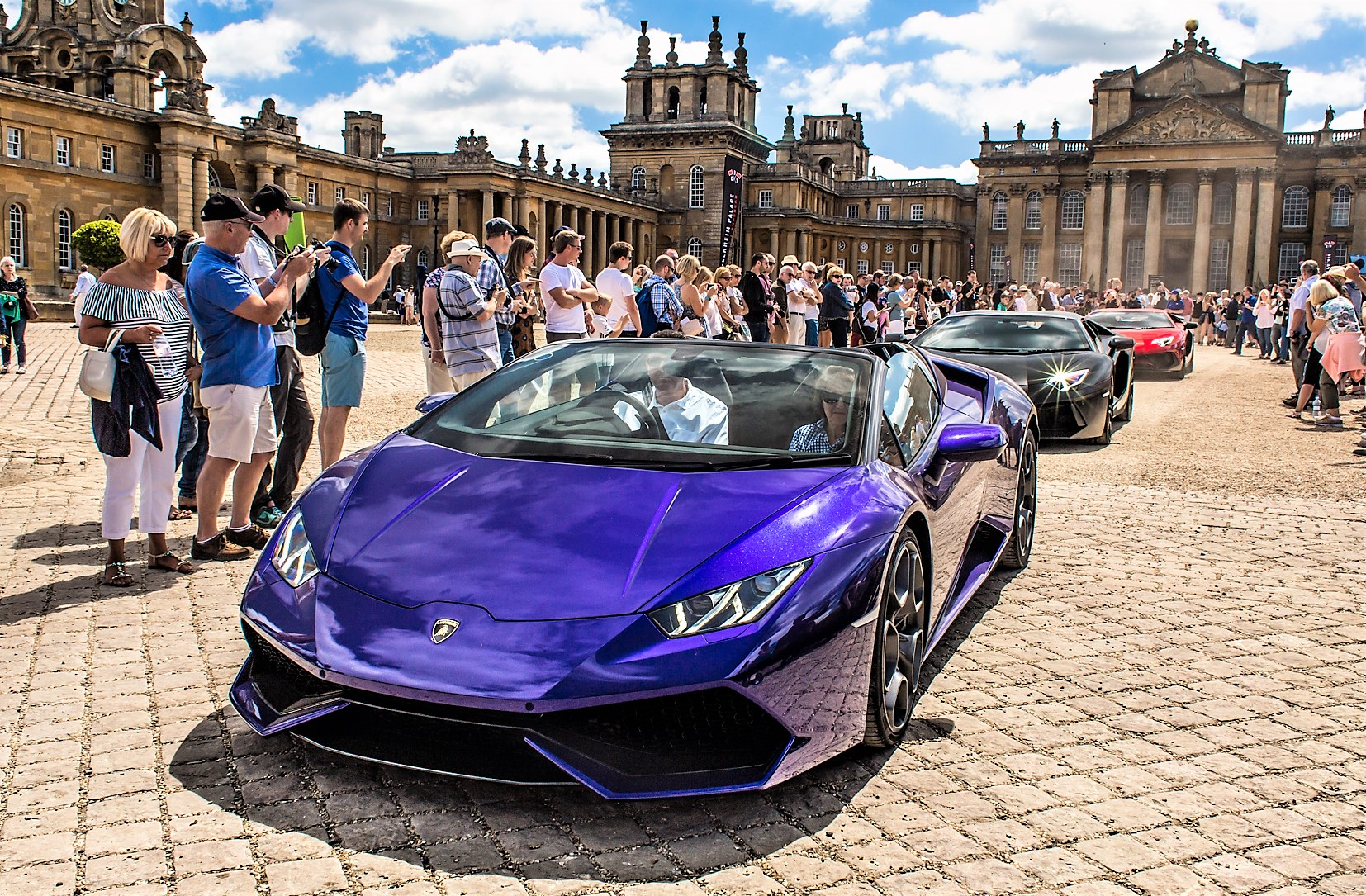 Supercars roll past the crowd at Blenheim Palace | Blenheim