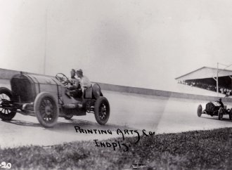 Benz races in the inaugural running of the Indianapolis 500