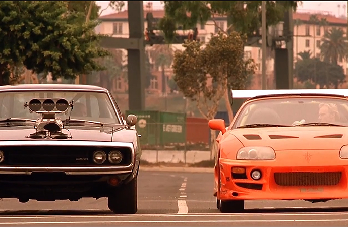 Two of the film's hero cars -- a 1970 Dodge Charger R/T and a 1993 Toyota Supra -- can fetch a premium price. | Screenshot
