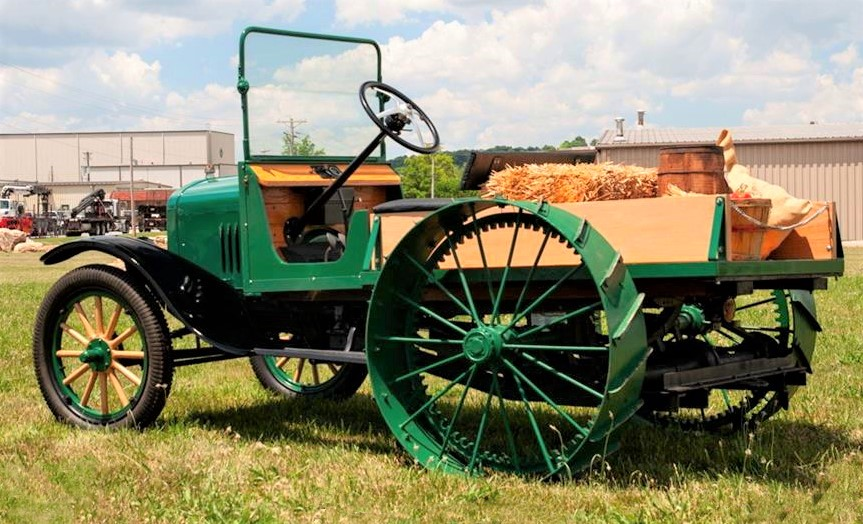 The tractor wheels and other items were added to the Ford back in the day