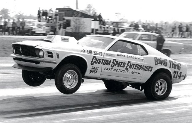 The Boss 429 pulls a wheelie in its racing days