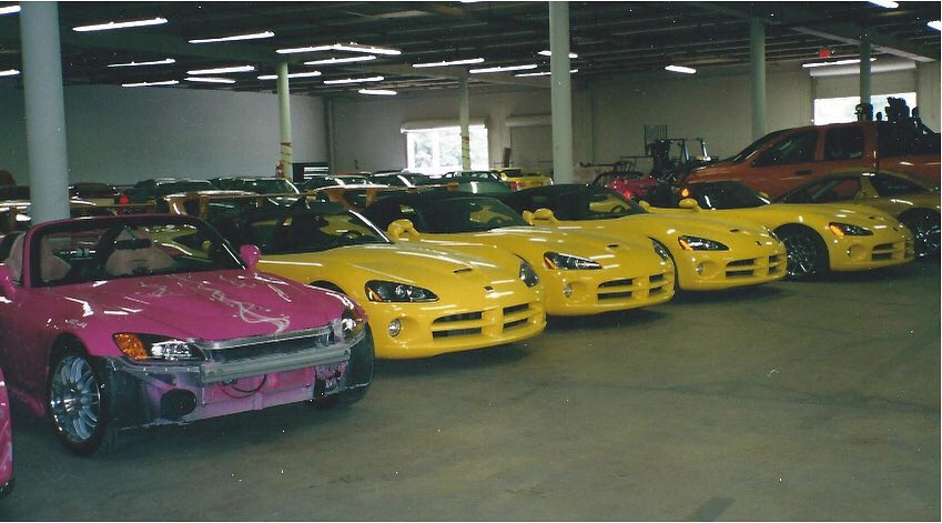 A garage full of cars used in 2 Fast 2 Furious includes several Dodge Vipers. The pink Honda S2000 on the left was driven by actress Devon Aoki. | Instagram photo
