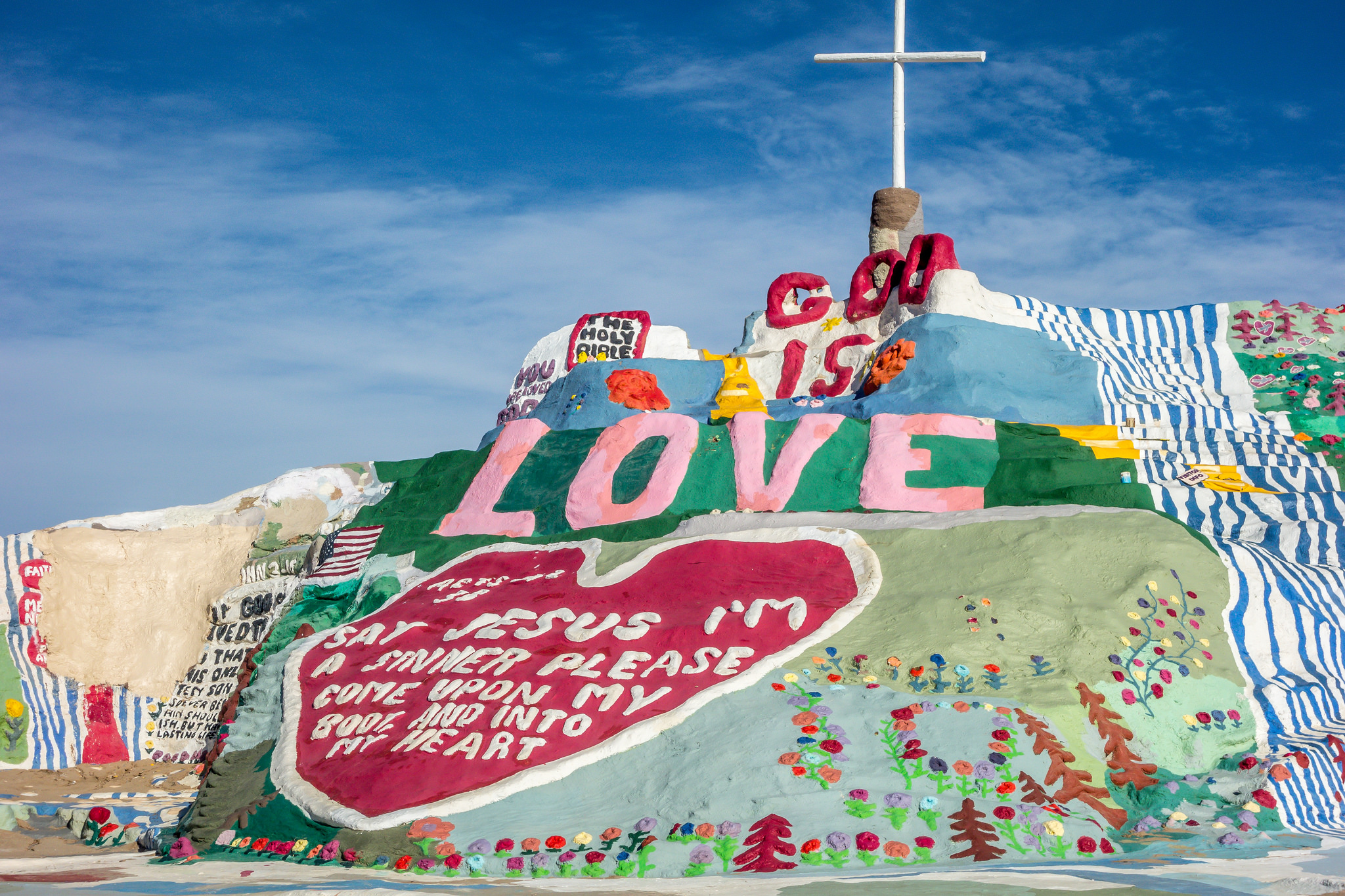Salvation Mountain is a bright spot in the middle of the California desert. | Flickr photo by Kevin Dooley without alterations under license CC 2.0