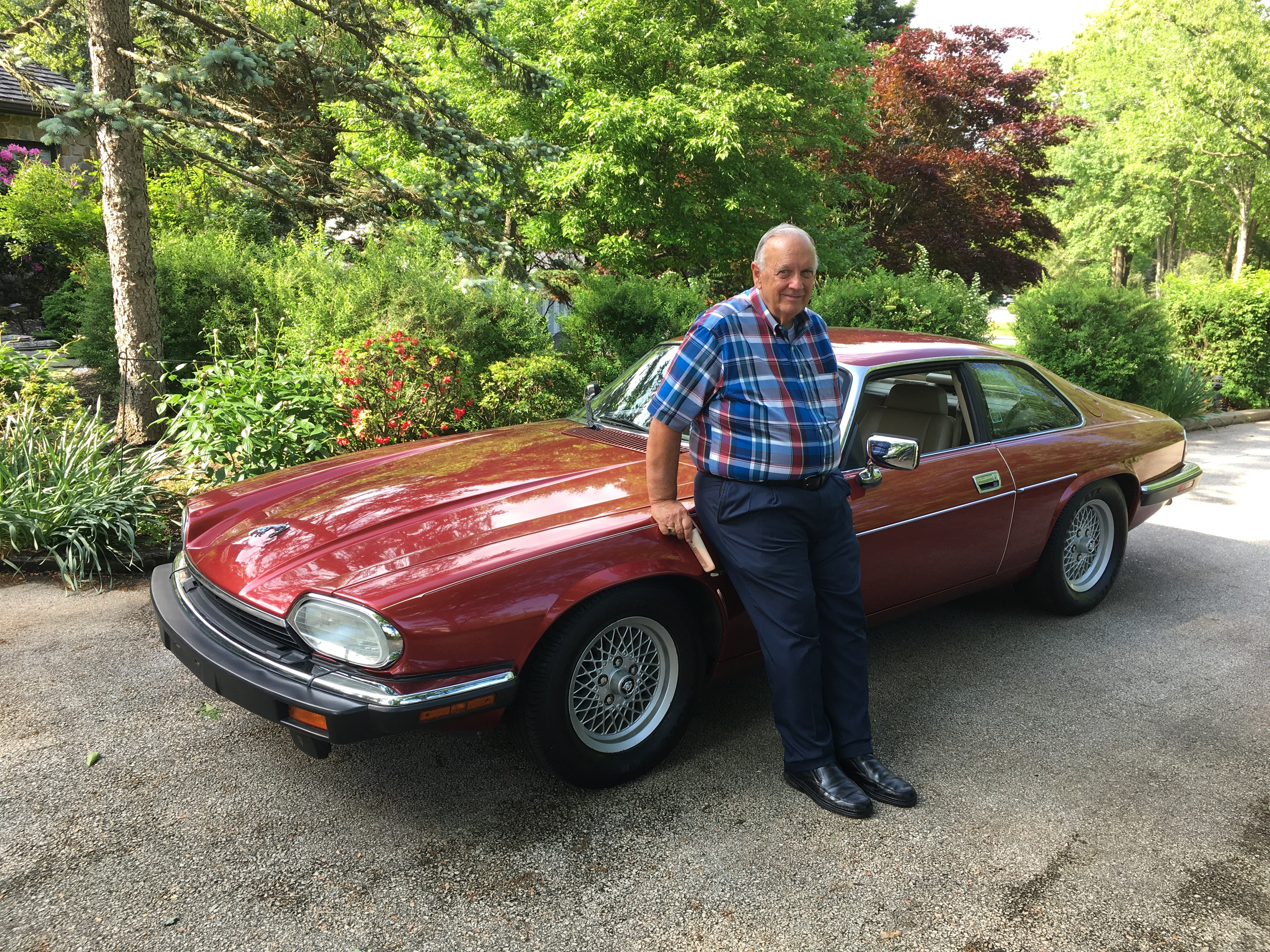 C.M.'s father poses next to a 1993 Jaguar XJS, one of a few classic cars owned by his son. | Submitted photo