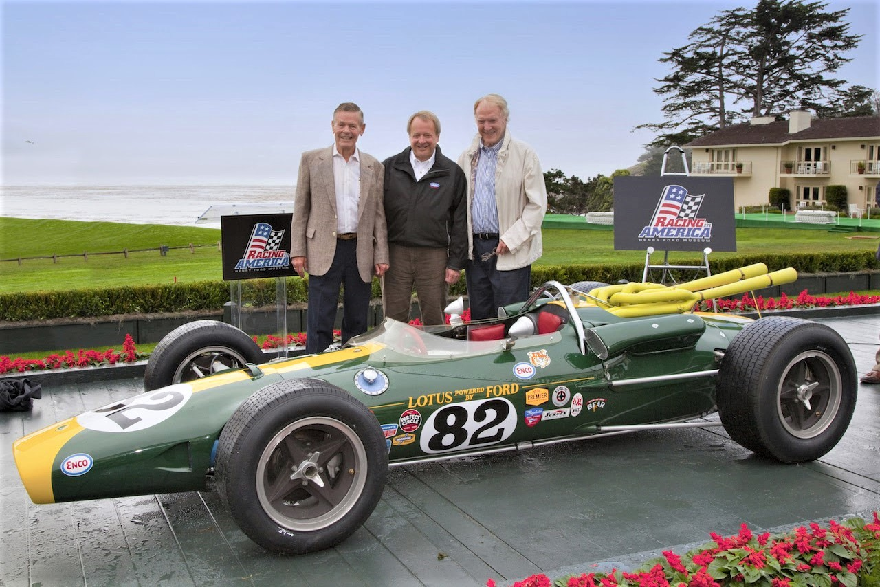 The Lotus-Ford 38 that first won Indy, shown at Pebble Beach in 2010 with champion drivers Bobby Unser (left) and Dan Gurney (right), along with Edsel B. Ford II | Pebble Beach Concours photos