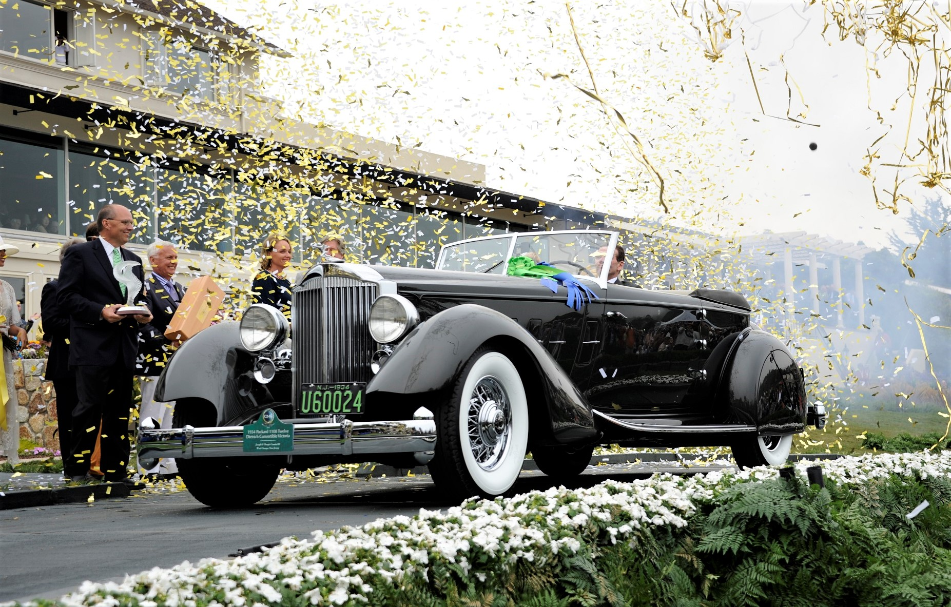 The Packard receiving its coveted Best of Show award at the Pebble Beach Concours