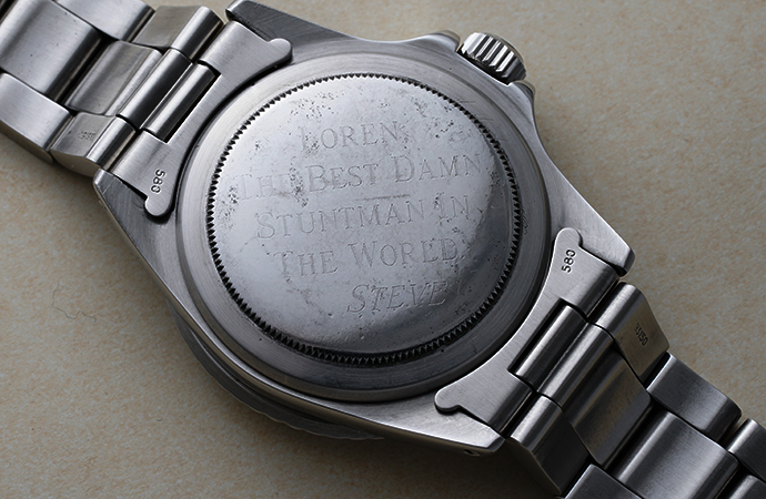 """This digitally enhanced photo shows the inscription on the back of the watch. It reads, """"Loren. The best damn stuntman in the world. Steve."""" 