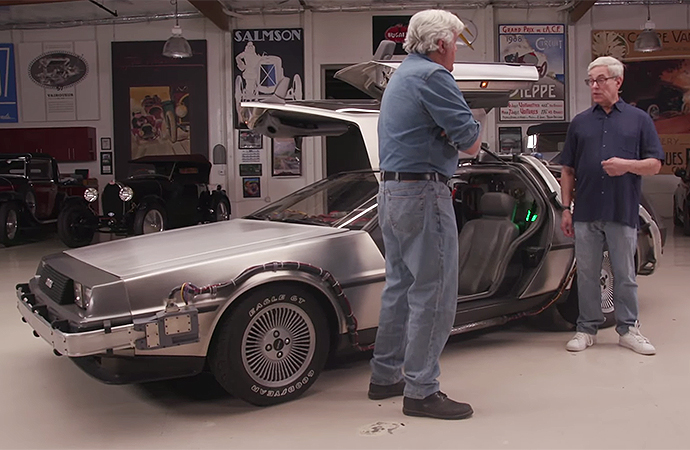 Back to the Future creator Bob Gale (right) stopped by Jay Leno's Garage with a replica DeLorean time machine. | Screenshot