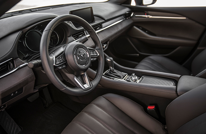 The interior has a refined feel brought about by real wood and suede inserts in addition to Nappa leather seats. | Mazda photo