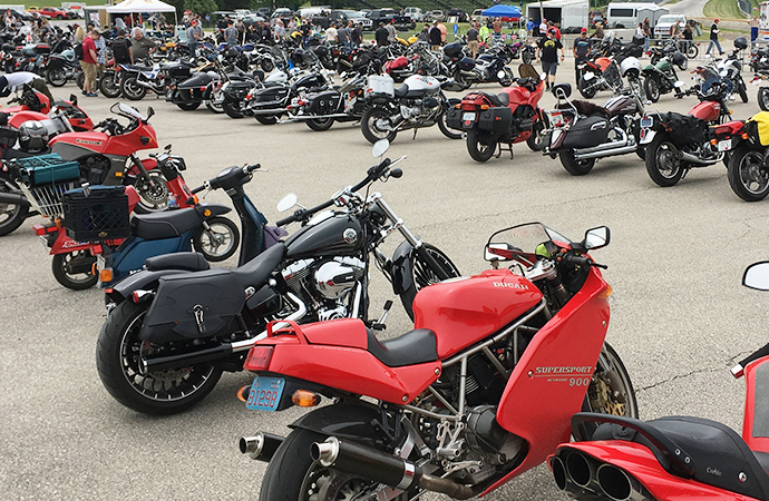 A sea of motorcycles takes over the lower paddock at Road America for Rockerbox/Vintage MotoFest.   William Hall photo