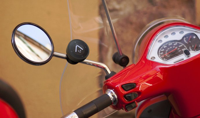 Mount for scooters and mopeds that clamps to the rear view mirror stalk. | Kickstarter photo