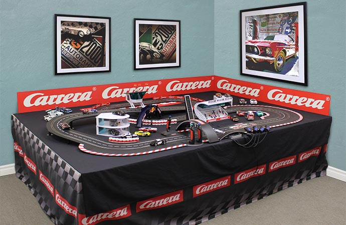 Automotive prints from FramedArt.com line the walls at Carrera Toys. | Carrera Toys photo