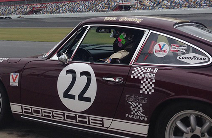 Bailey is seen sitting inside his treasured No. 22 Porsche. | RACEMARK photo