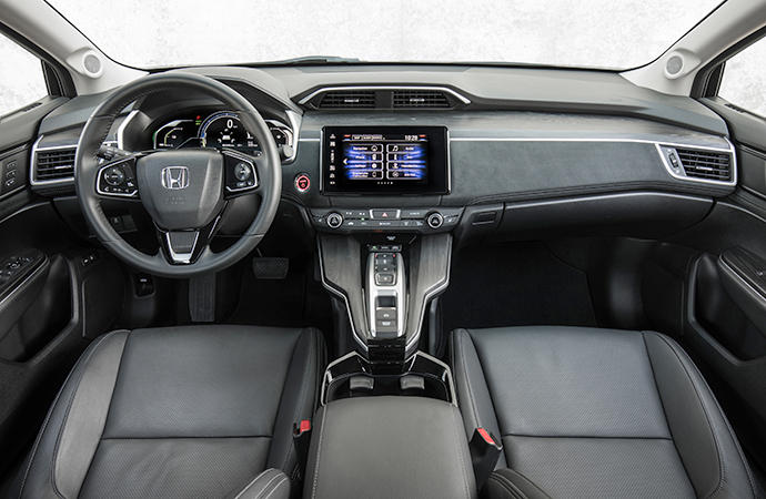 The interior of the Clarity is sleek and simple and the tablet-esque infotainment system works well as a focal point. However, the cheap-feel buttons on the steering wheel are a miss. | Carter Nacke photo