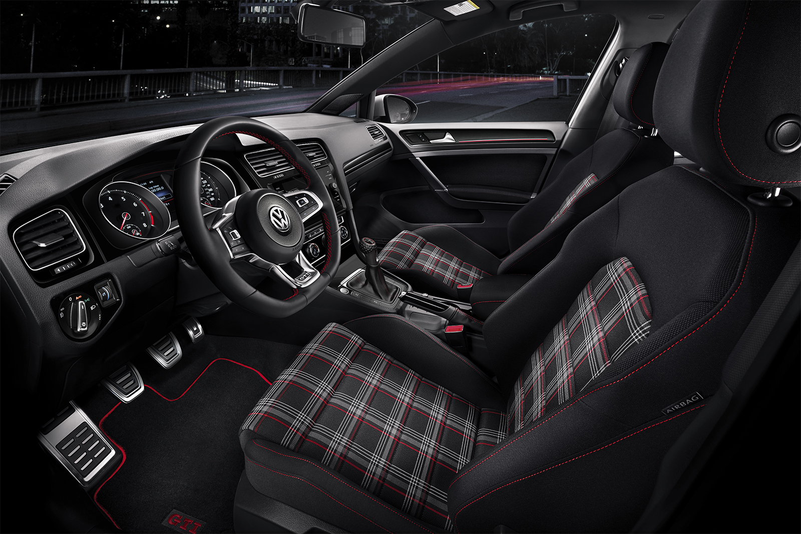 The GTI's interior is a great blend of technology and the car's roots. This photo is of a model equipped with a manual transmission, but the interior of the one I drove was very similar. | Volkswagen photo