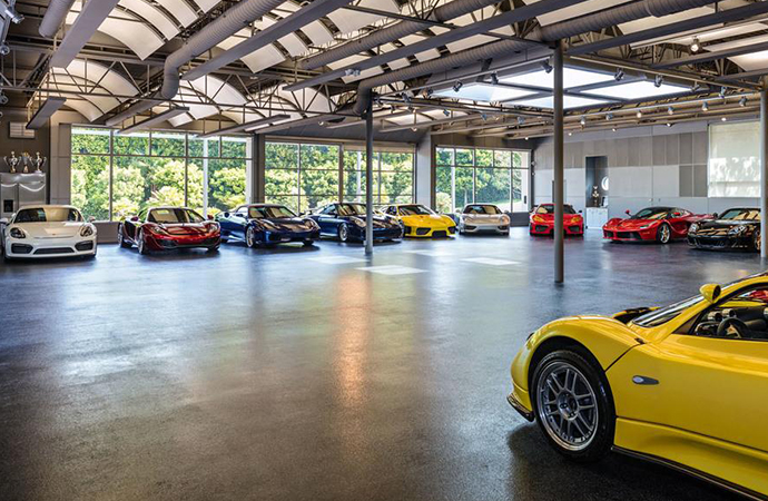 Talk about home sweet home: A California home that sold for more than $7.3 million easily double as an automotive museum thanks to a garage that fits at least 25 cars. | Estately photo