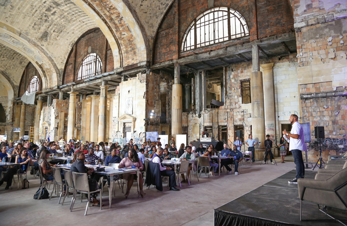 A Ford official addresses a crowd of millennial leaders. The company sought input from the community about how it should revamp a historic train station that will be a centerpiece of a new Detroit campus. | Ford Motor Company photo