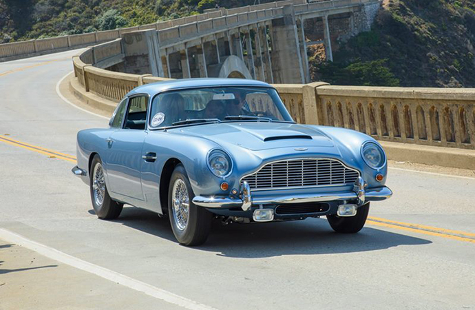 A 1965 Aston Martin DB5 makes its way on the Pebble Beach Tour d'Elegance. | Facebook photo