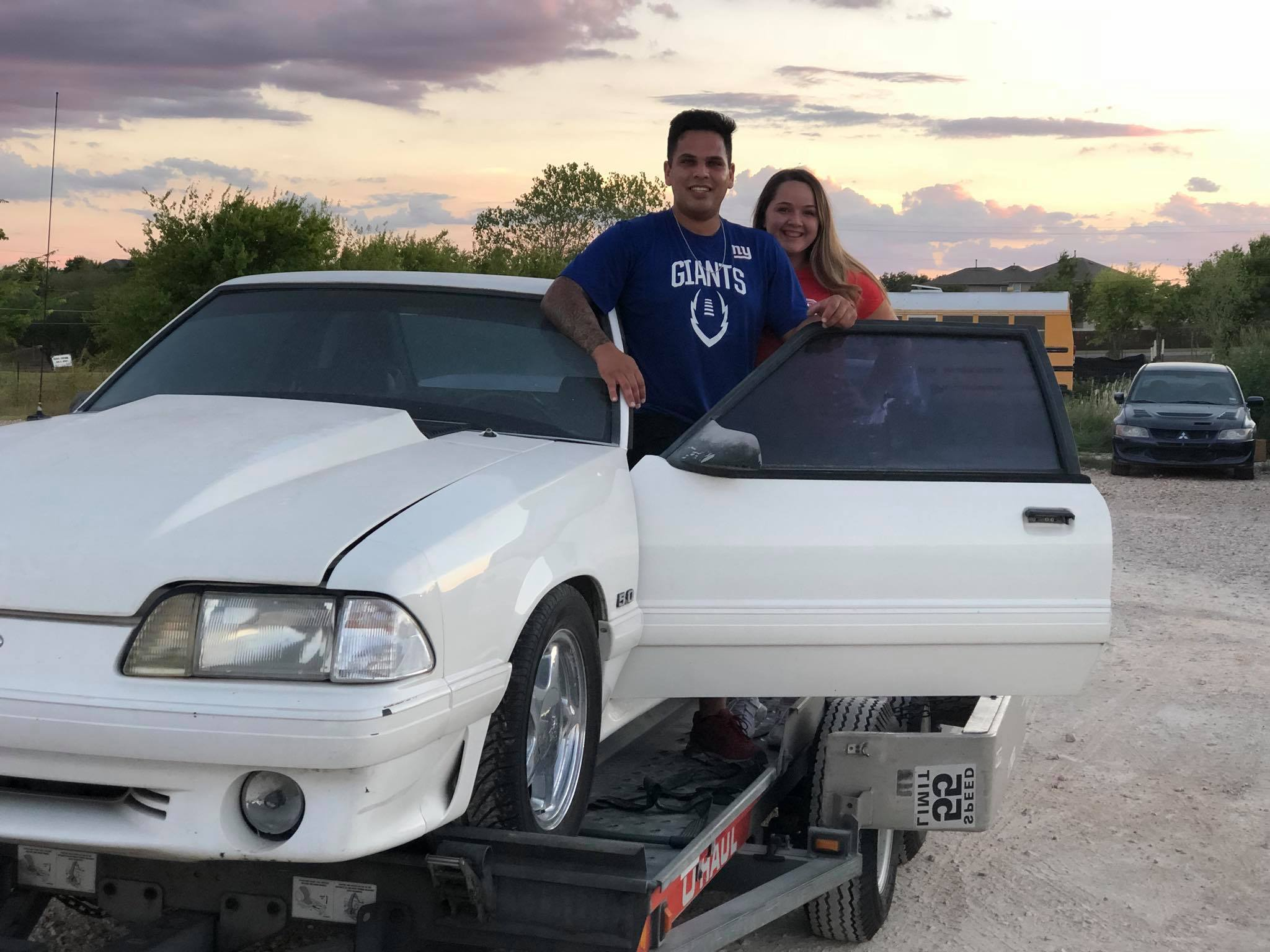 Jake and Jeni pose with the car before surprising their father. | Facebook photo