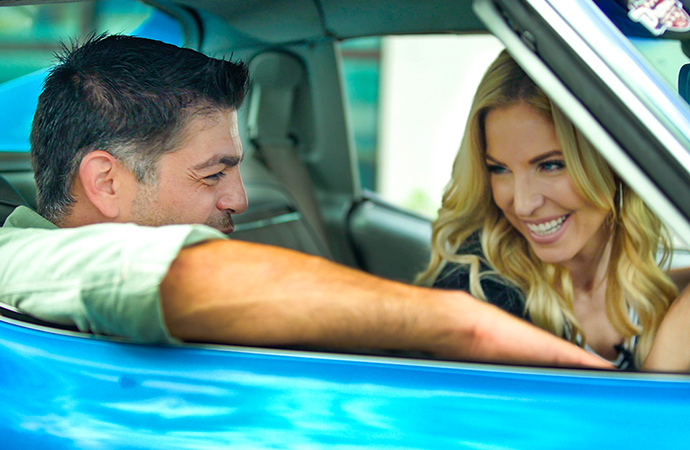 In the debut episode of Driven, hosts Nick Calderone (left) and Kristen Keogh jump behind the wheel of a 1975 Chevrolet Corvette Stingray. | ClassicCars.com photo