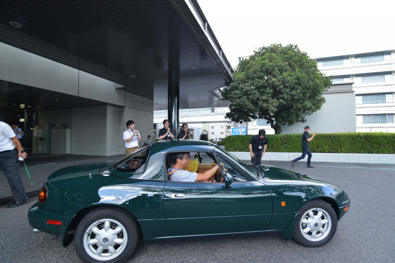 Keiji and Norimi Nishimoto drive away in their 1992 Eunos Roadster. It cost more than a new car to complete the work, but Keiji said it was worth it. | Mazda photo