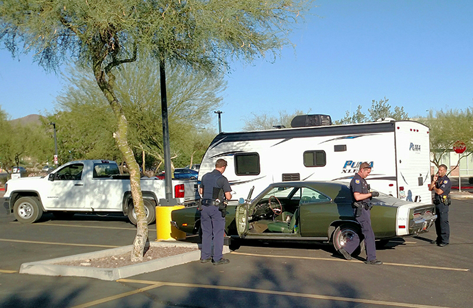 Police were called to a Walmart parking lot where officers found the car and arrested the suspects. | Michael Laiserin