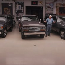 Jay Leno inspects a trio of 1980s-era Toyota Land Cruisers
