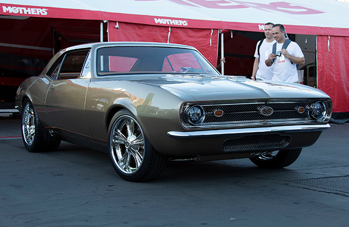 SEMA Show attendees check out a 1967 Chevrolet Camaro SS nicknamed Nickelback that won the Mothers Shine Award. | Mothers photo