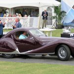 -5be704cfb7190–5be704cfb7192xx Peter Mullin (left), with his 1938 Talbot Lago T150-C-SS, tells concours MC Keith Martin about his love for French coachbuilt cars.JPG