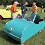 Specators ponder a tiny, toylike 1953 Ardex from the Lane Museum.JPG