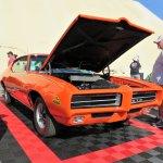 Spectators admire the Muslce Car of the Year, a Pontiac GTO.JPG