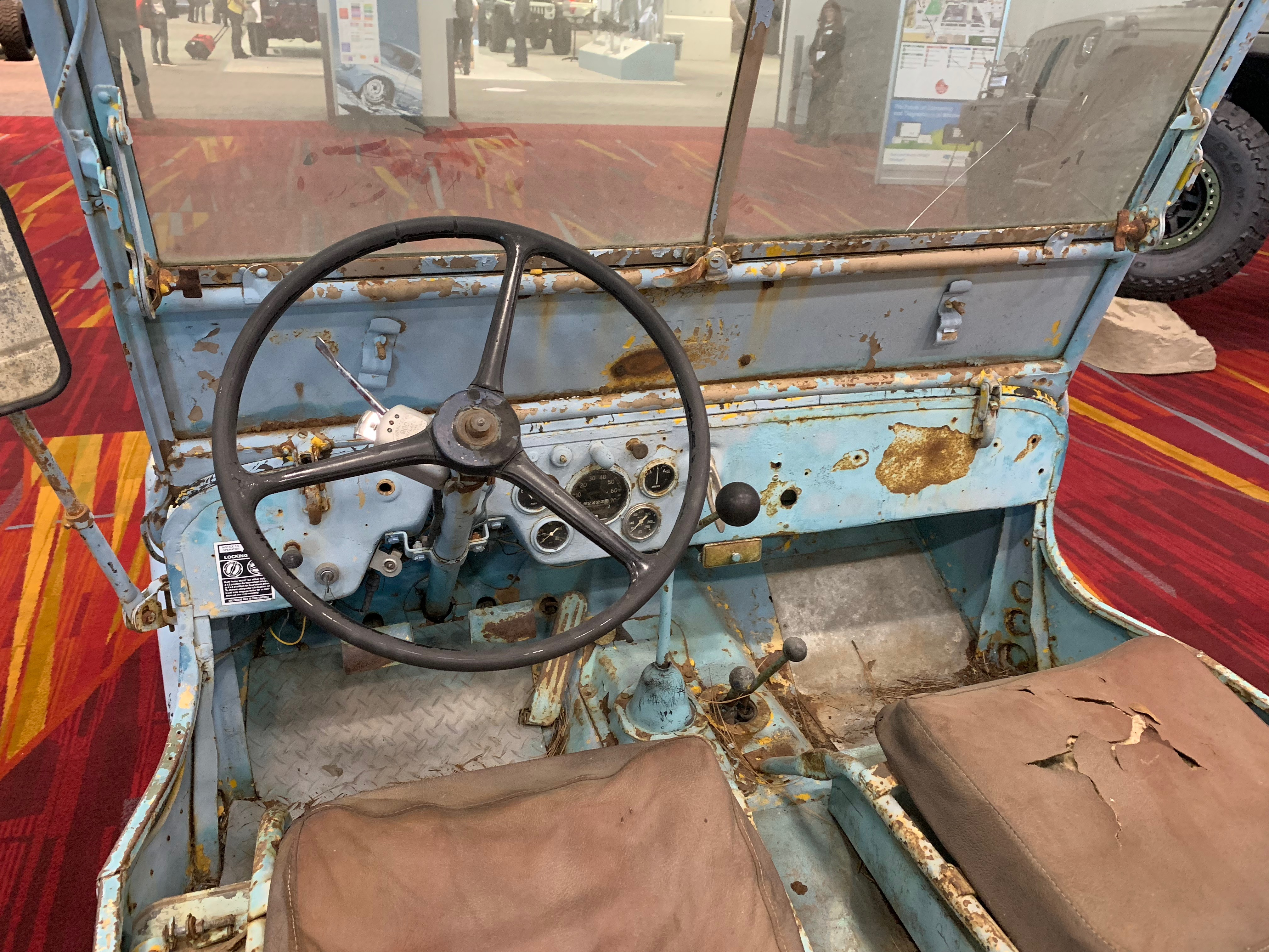 Amid all the polish and shine at the 2018 SEMA Show in Las Vegas sits this unrestored 1946 Willys CJ-2A. | Carter Nacke photo