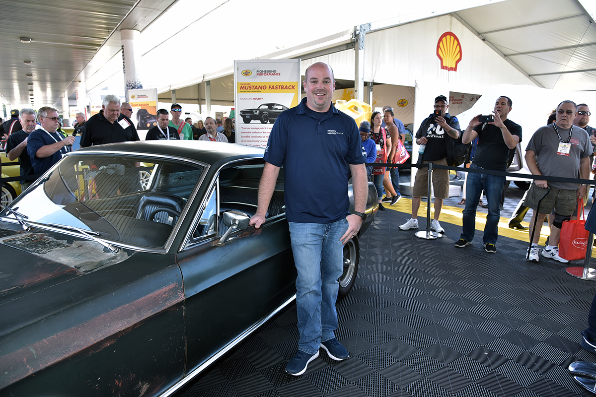 Kiernan stands next to the original Bullitt Mustang his father bought 44 years ago. | Shell photo