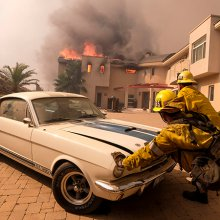 Firefighters seen pushing classic Mustang Shelby GT350 from burning California home