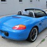 Blue Porsche Boxster top down rear