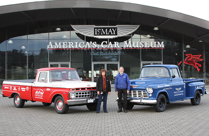 Renee Crist and Dale Wickell of America's Car Museum with two trucks from the Drive Home IV. | America's Automotive Trust photos