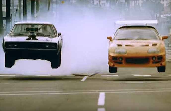 Have you ever seen a Dodge Charger and Toyota Supra not only race, but jump train tracks in the process? It happens in <i>The Fast and the Furious</i>. | Universal Pictures