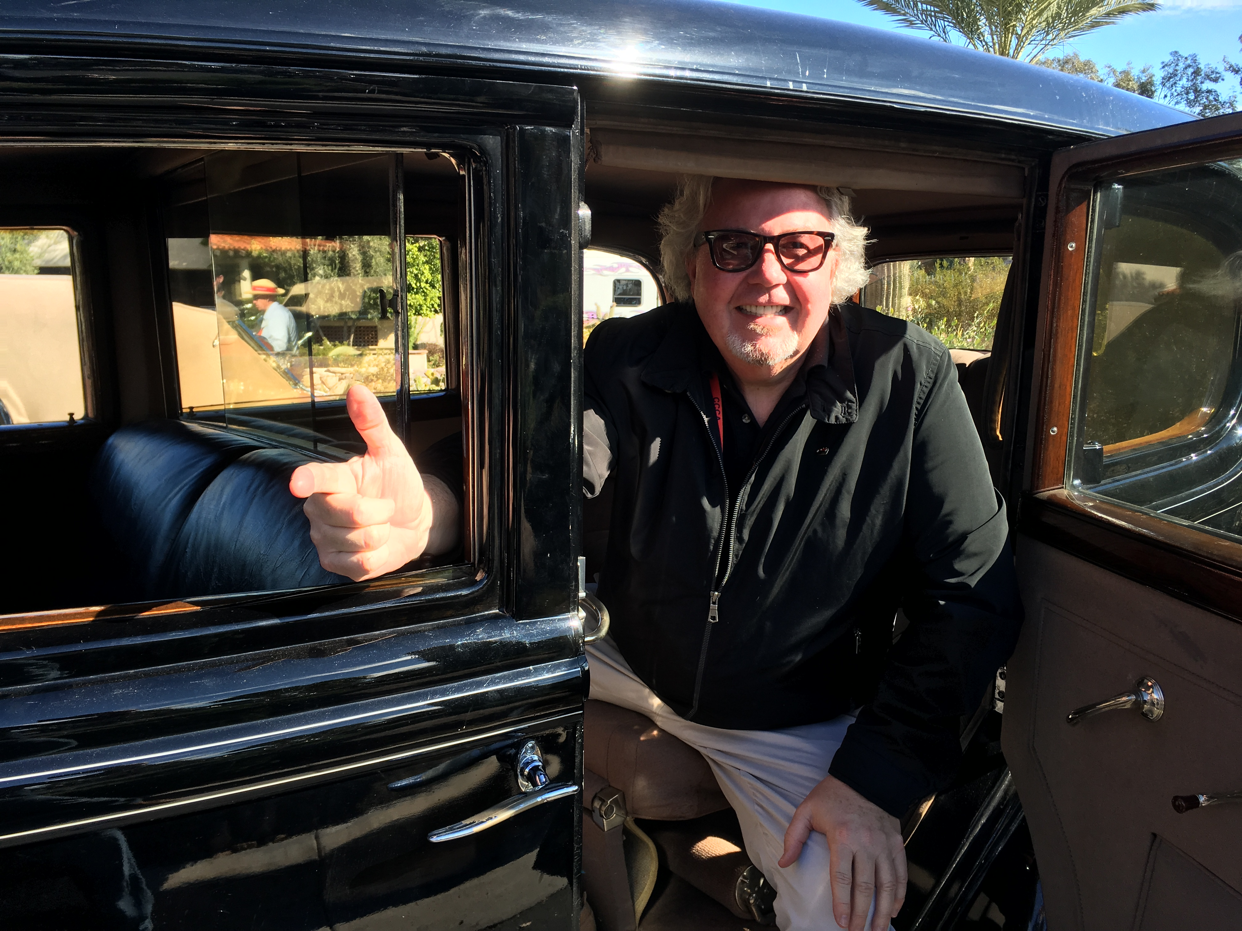 Quail demonstrates the shooting position from his 1933 Lincoln limousine.