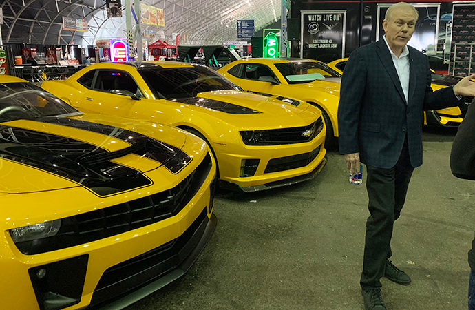 Jackson speaks to media near four Camaros used in the Transformers films that will be sold as a group for charity.