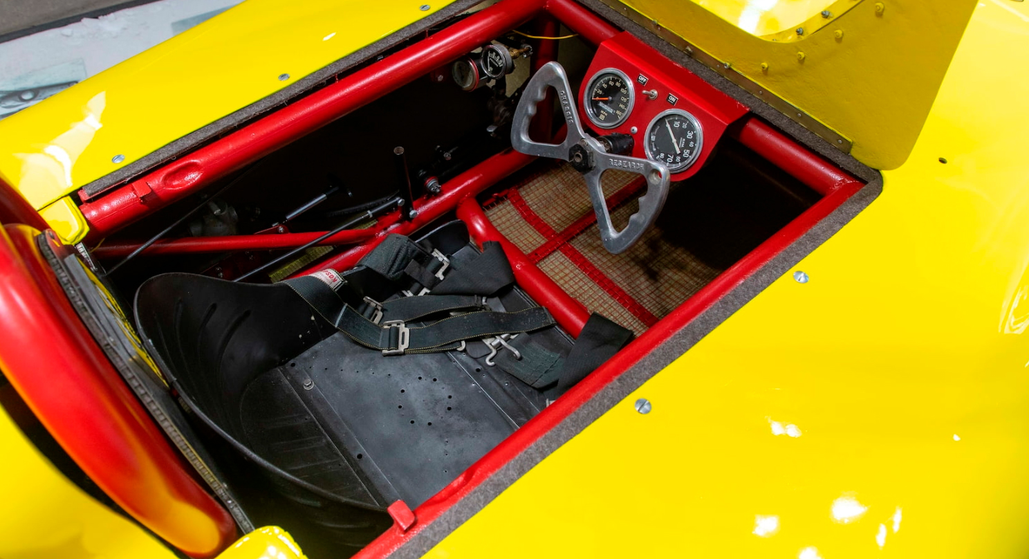 There was barely enough room for Burke to fit in the diminutive speedster. | Mecum photo