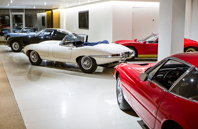 A JD Classics showroom is shown. The dealer's founder, Derek Hood, and his wife have been sued and accused of inflating values for some cars. | Facebook photo