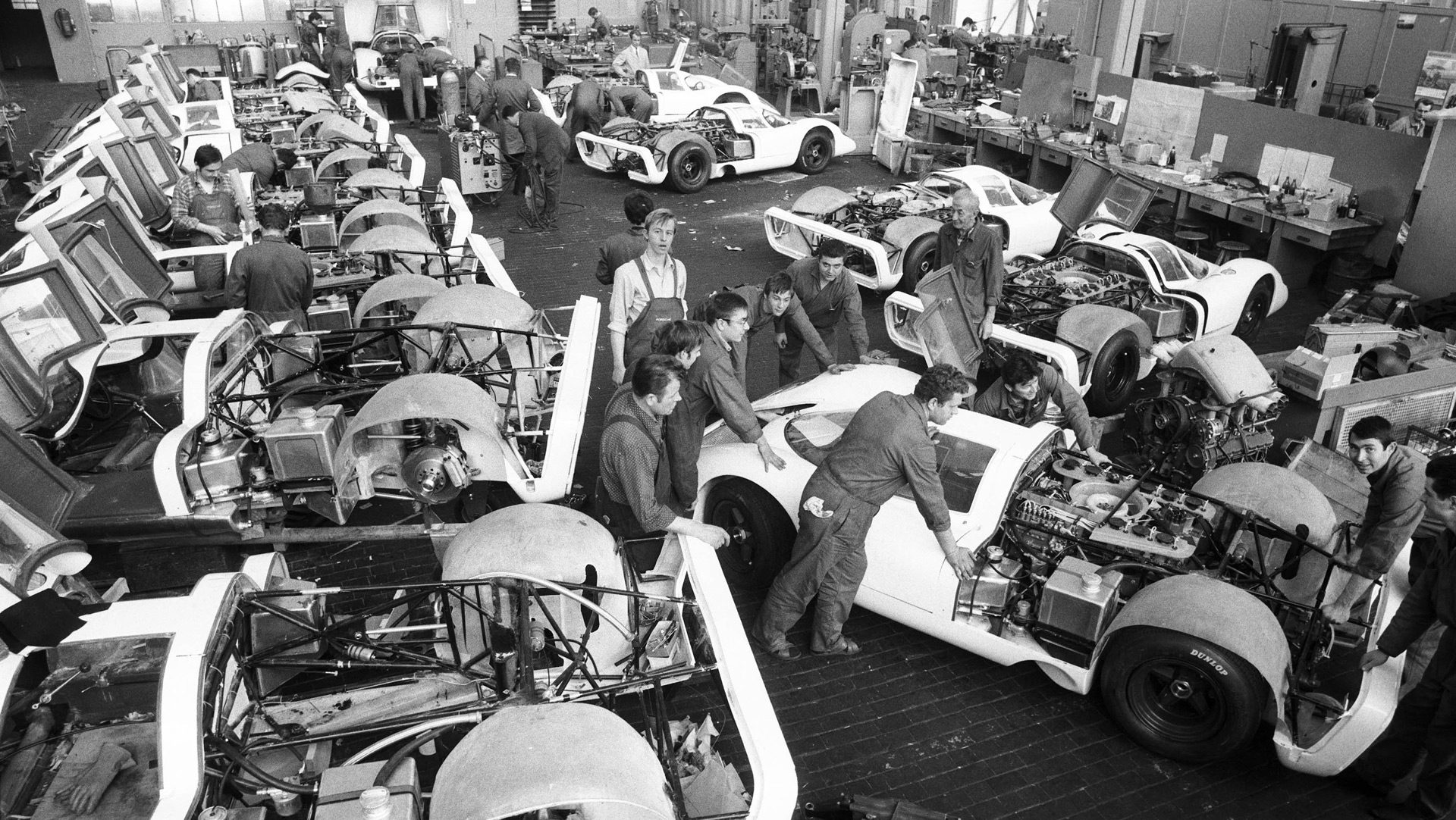 Porsche technicians work on the original 917s.