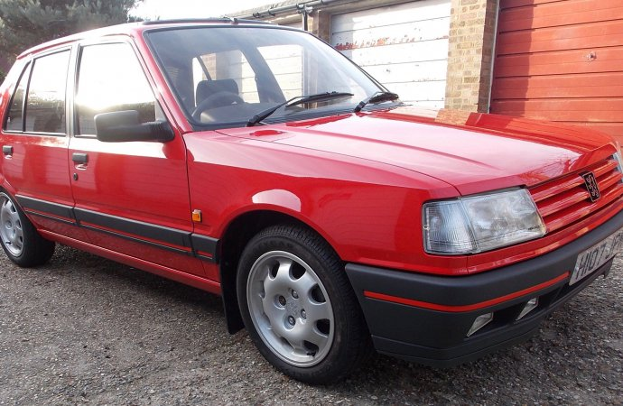 131-mile Peugeot 309 GTi brings $145 per mile at auction